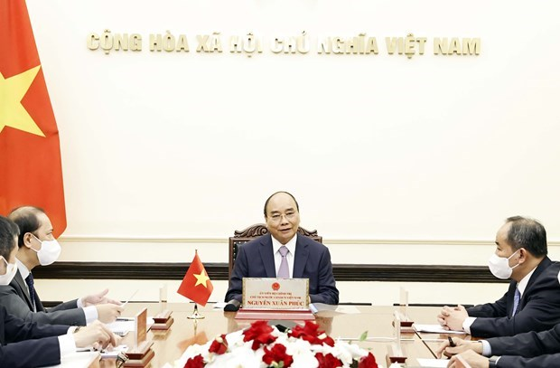 President holds online talks with Japanese Prime Minister hinh anh 1