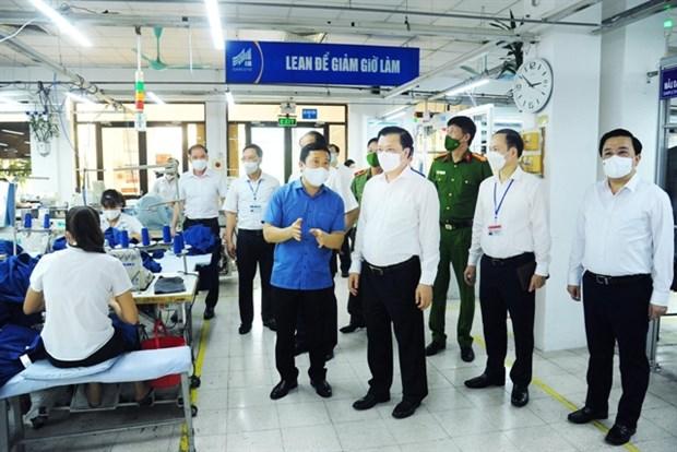 Enterprises take flexible scenarios to recover after social distancing hinh anh 1