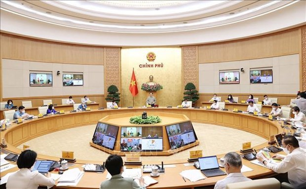 PM highlights need for safe adaptation to pandemic, containment solutions hinh anh 1