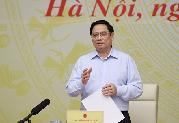 PM, business circle discuss ways to tackle pandemic-caused difficulties hinh anh 1