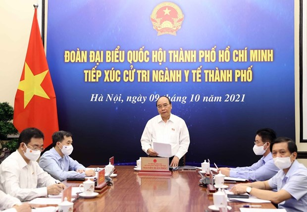 President urges HCM City to control risks following reopening measures hinh anh 1