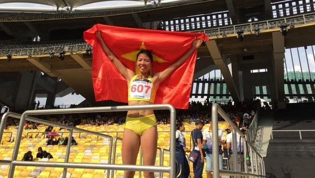 3b6c4cc3a1bb40 Long jumper Bui Thi Thu Thao celebrates her victory at the 29th SEA Games  last August (Photo  thethaovanhoa.vn)