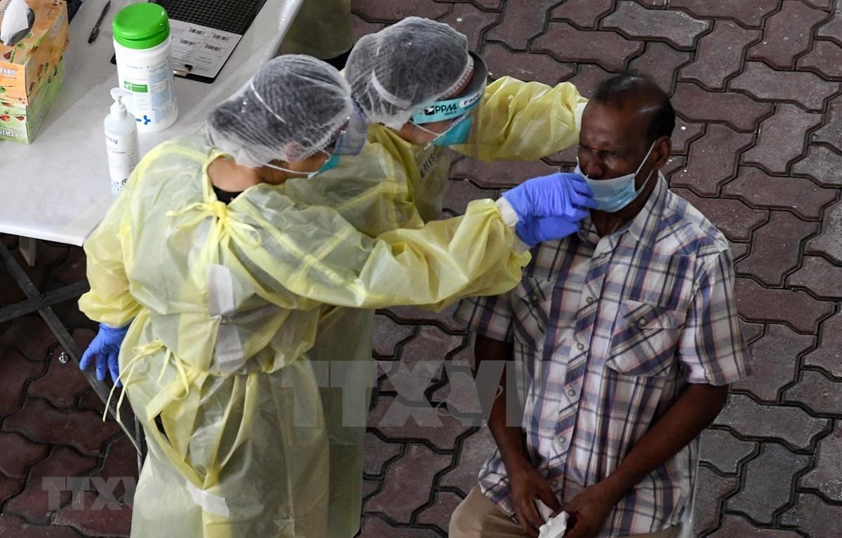 Singapore tightens preventative measures to combat COVID-19